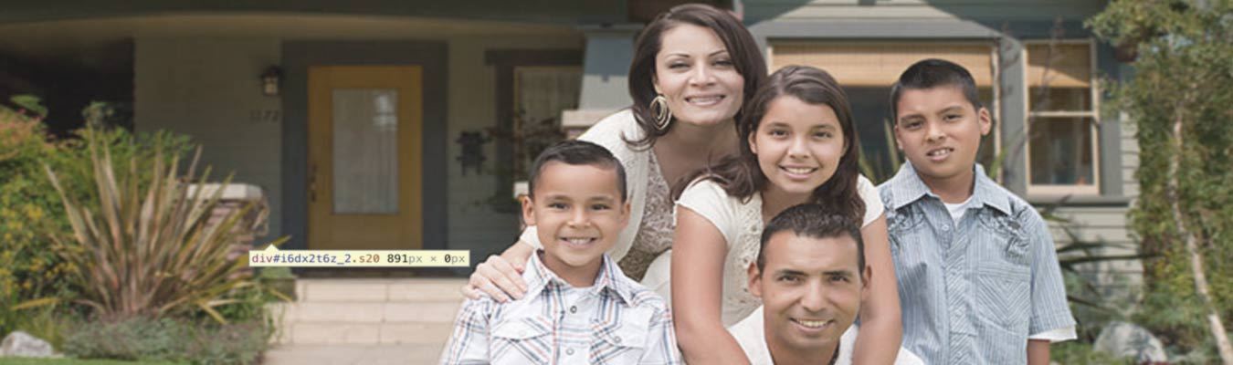 A Hispanic family poses in front of their home.
