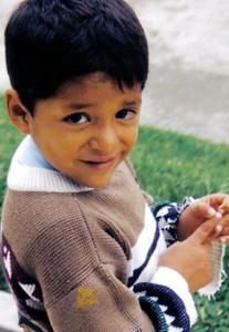 Small Peruvian boy looks at the camera.
